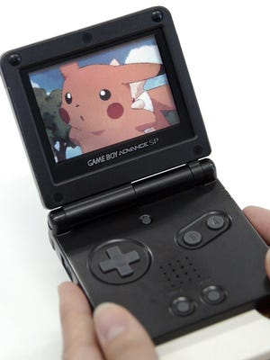 In this July 23, 2004, file photo, Pikachu is shown in a movie playing on the screen of Nintendo's Game Boy Advance in Tokyo.