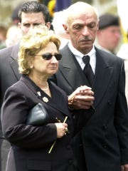 -  -Text: Joan and Thomas Esposito of Pearl River, parents of Capt. Phillip Esposito, leave St. Anthony's Church in Nanuet June 15, 2005 following a funeral mass for their son, a Rockland reservist killed in Iraq last week. ( Vincent DiSalvio / The Journal News )W/EASLEY STORY rfr