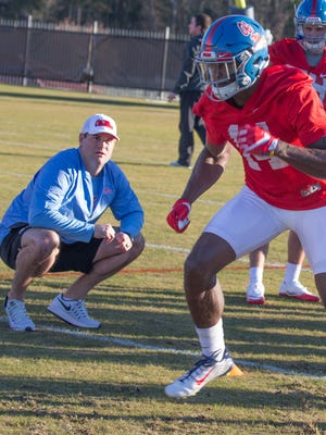 New Ole Miss receivers coach Jacob Peeler (left) inherits a group, which features D.K. Metcalf (right).