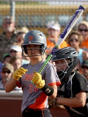Petrolia's Raeley Mataska looks to her coach before stepping in the batter's box in Game 1 of the Region I-2A final against Archer City Thursday, May 26, 2017, in Bowie. The Lady Cats defeated the Lady Pirates 4-3.