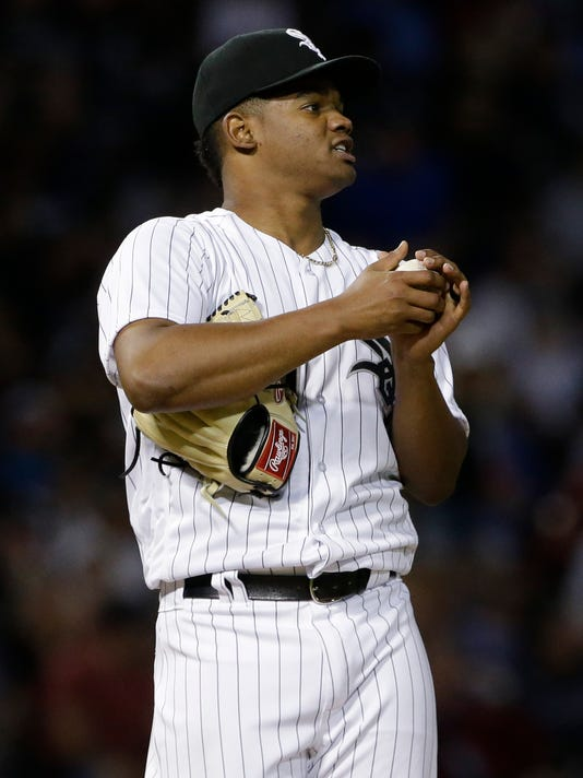 Chicago White Sox starting pitcher Reynaldo Lopez reacts after Kansas City Royals' Mike Moustakas hit a solo home run during the fourth inning of a baseball game Friday, Aug. 11, 2017, in Chicago. (AP Photo/Nam Y. Huh)