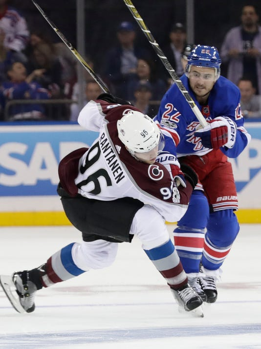 New York Rangers' Kevin Shattenkirk (22) collides with Colorado Avalanche's Mikko Rantanen (96) during the second period of an NHL hockey game Thursday, Oct. 5, 2017, in New York. (AP Photo/Frank Franklin II)