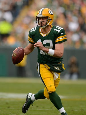 Packers quarterback Aaron Rodgers can make defenses pay with his feet, too.