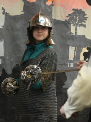 Wearing chainmail, a metal hat and sporting metal gloves, Lucy Brown, 13, Wausau, gets a sword fighting lesson at the Evercon gaming convention at D.C. Everest Junior High School in Weston, Saturday, January 11, 2014.
