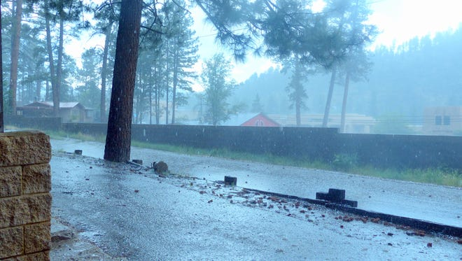 Streets were covered with hail as a supercell storm took its first swipe at Ruidoso about 3:30 p.m. Wednesday.