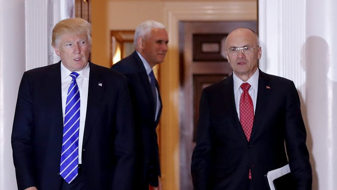 In this Nov. 19, 2016, file photo, Donald Trump appears with Andy Puzder at the Trump National Golf Club Bedminster clubhouse in Bedminster, N.J.