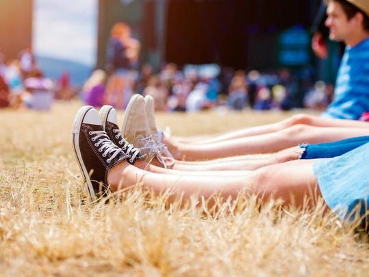 Legs of teenagers, music festival, in front of stage