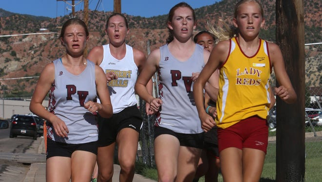 Region 9 runners compete in the Cedar All-Comers Cross Country Meet at Cedar High School Tuesday, Aug. 9, 2016.