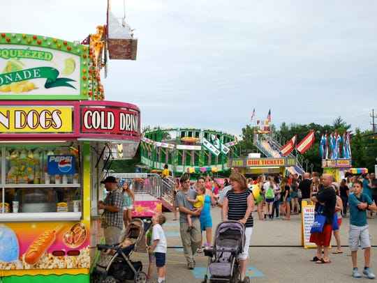 Crowds fill the midway to enjoy rides at Greater Anderson