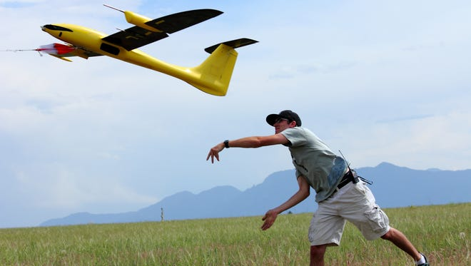 Graduate research assistant Kevin Rauhauser, with the University of Colorado's Research and Engineering Center for Unmanned Vehicles, launches the Tempest unmanned aerial vehicle for a test flight in June 2013 on Table Mountain, near Boulder, Colo. Researchers say they've collected promising weather data by flying instrument-laden drones into big storms, and now they want to expand the project in hopes of learning how tornados form