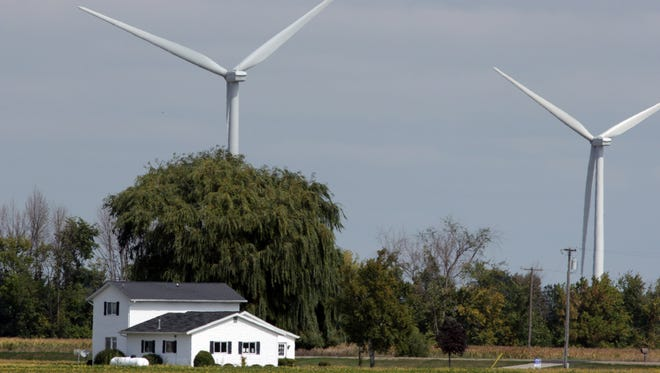 Wind turbines recently have come to Tuscola County and are all over farm country southeast of Bay City. Picture taken in  2013.