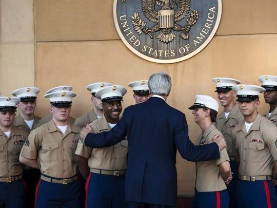 Secretary of State John Kerry greets U.S. Marines as