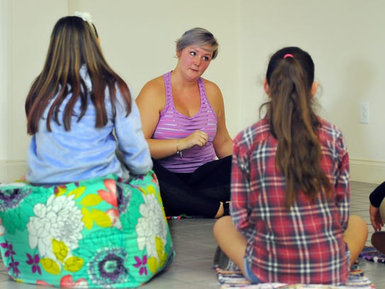Allison Kimmey of  Satellite Beach talks to a group