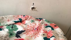 A bullet hole in the wall above the bed where an 11-month-old