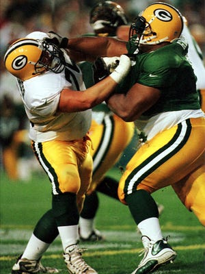 Craig Heimburger, left, played in two games for the Green Bay Packers as a rookie guard in 1999.