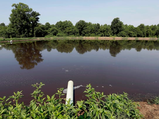 In this July 21, 2017 file  photo, a hog waste pond
