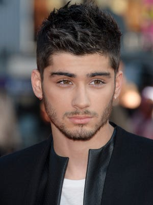 File - Zayn Malik flies home from One Direction tour with stress in this Tuesday, Aug. 20, 2013 file photo Zayn Malik arrives for the UK Premiere of 'One Direction: This Is Us 3D' at a central London cinema, (Photo by, file) ORG XMIT: LJS101