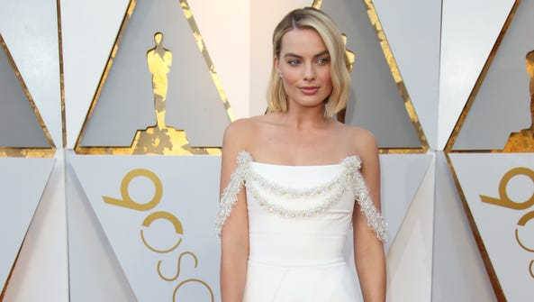 Margot Robbie arrives at the 90th Academy Awards.