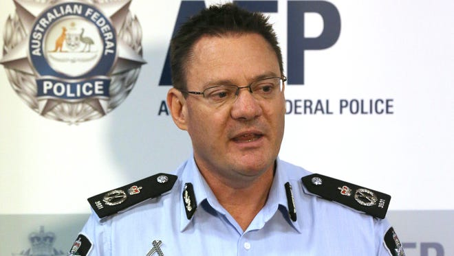Australian Federal Police Deputy Commissioner Michael Phelan informs the media that two Sydney men have been arrested by the Joint Counter Terrorism team in Sydney, Australia, Wednesday.