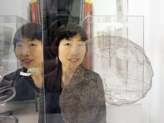 Artist Jayoung Yoon at work in her studio space in
