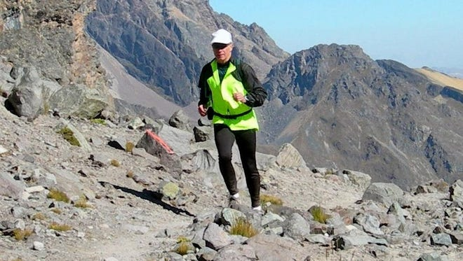 Walt Pheney runs the rocky Inca Trail in the Andes Mountains of Peru.