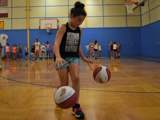 Young players practice drills on June 13, 2018 at Leta