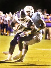 Haywood's Decourtney Reed tries to break away from a USJ defender on Sept. 1, 2017.