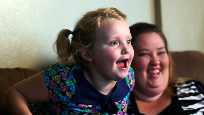 "Beauty pageant regular and reality show star Alana ""Honey Boo Boo"" Thompson speaks during an interview as her mother June Shannon looks on in her home in McIntyre, Ga. on Sept. 10, 2012."