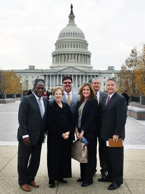 A delegation organized by the San Angelo Chamber of Commerce traveled to Washington, D.C., in November to update Pentagon officials and Senate and congressional leaders on operations and future needs at Goodfellow Air Force Base. Pictured near the U.S. Capital are  (from left) retired Air Force Lt. Gen. Ronnie Hawkins; Dr. Carol Ann Bonds, former superintendent of San Angelo Independent School District and chairwoman of the Chamber's Military Affairs Committee; Alvin New, chairman of the Chamber Government Affairs Committee; Chamber Board of Directors Chairwoman Jamie Akin; Tom Green County Judge Steve Floyd and Chamber President Dan Koenig.
