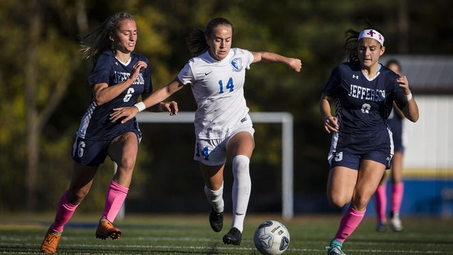 Kittatinny's Lauren Wrigley, center, controls the ball as she is defended by Jefferson's Juliana Aromin, left, and Felicia Gall during their game on Oct. 15, 2019, at Jefferson Township High School.