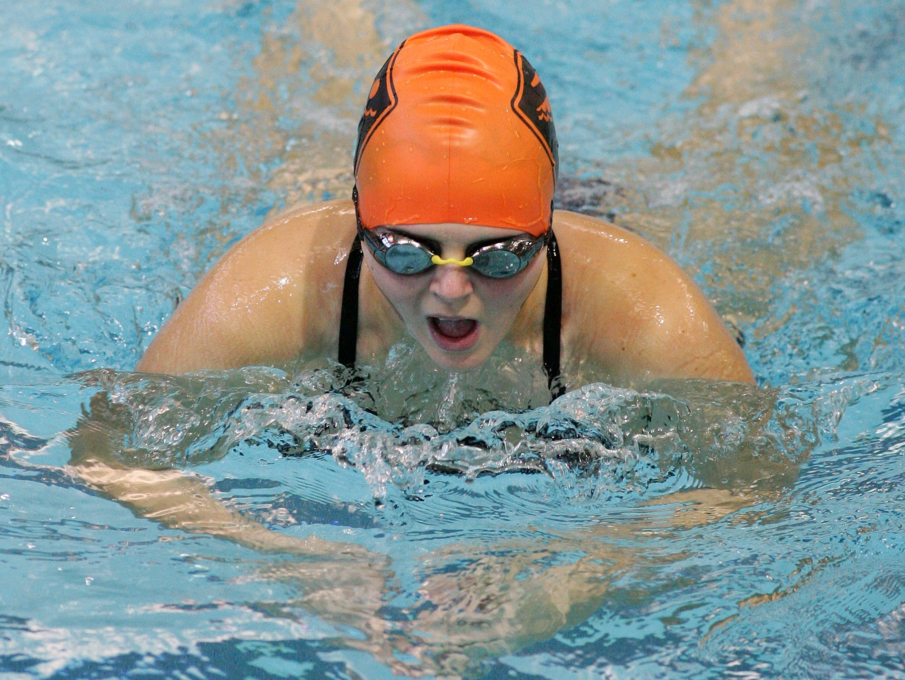Watkins Memorial's Hailey Miller practices with the team Tuesday at Denison.