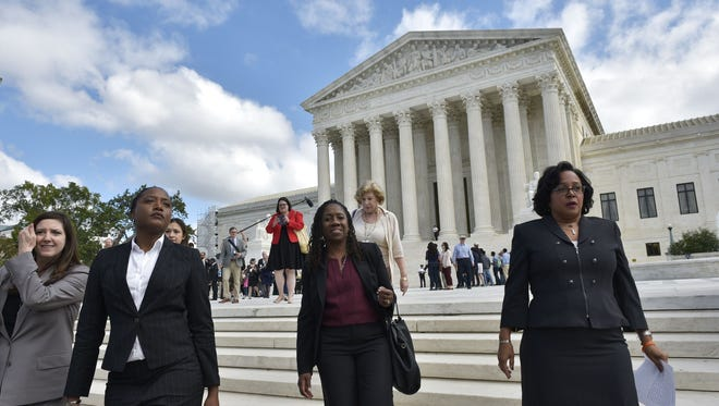 Christina Swarns, right, the lead counsel for Duane  Buck, at the Supreme Court on Oct. 5, 2016.