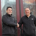 White Rose general manager Jeremiah Anderson and longtime owner Tom Sibol, right, stand in front of the former Maewyn's Irish Pub, which the duo purchased. They recently named the future York City seafood restaurant Rockfish Public House. (Photo by David Weissman)