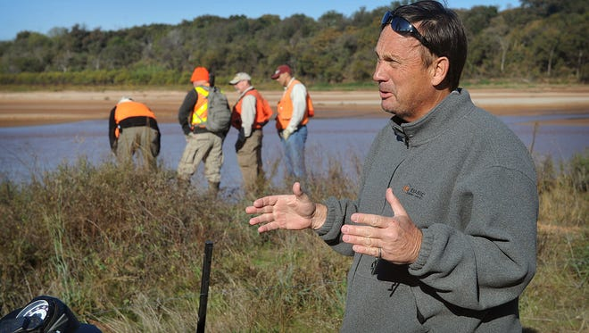 Land owner Kevin Hunter in 2016, watches as a survey crew and special agents from the Bureau of Land Management began mapping the northern edge of his property to determine the gradient boundary of the Red River and thus his property line. The BLM maintains that line is actually 1.3 miles back from the river which means Hunter could lose about two-thirds of his 352-acres.