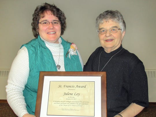 Sister Julien Dirkes, right, presented the Saint Francis