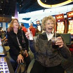 Kathy Curley, left,  celebrates their winnings with her mother Peggy Jones, the first VIP into the new Desert Diamond West Valley Casino, Sunday, Dec. 20, 2015 near Glendale, Ariz. Peggy's husband was a big proponent of the casino. She won twenty-one cents on her first try.