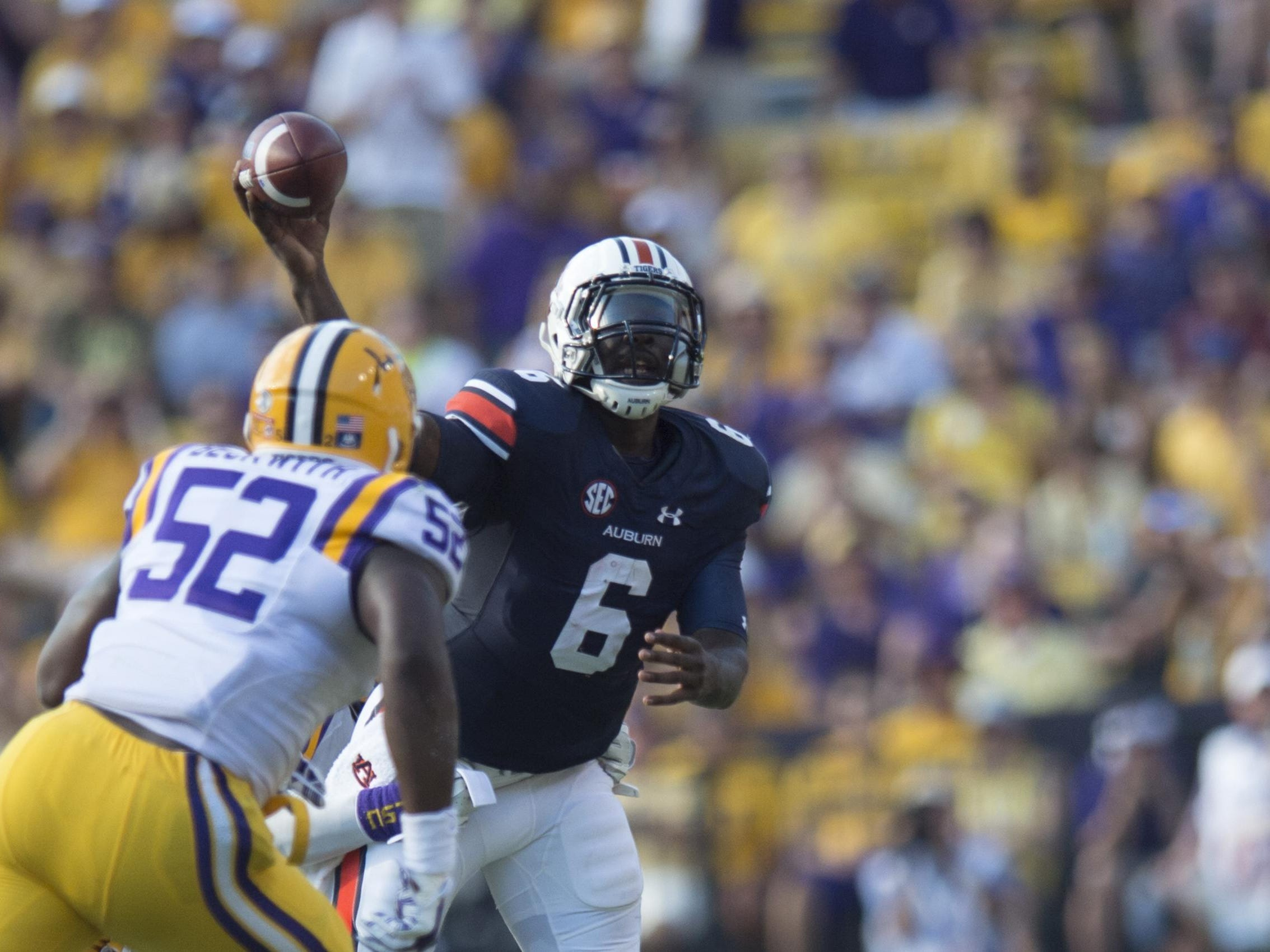 Auburn Tigers quarterback Jeremy Johnson (6) throws a pass as Louisiana State linebacker Kendell Beckwith rushes him during the NCAA football game between LSU Tigers and Auburn on Saturday, Sept. 19, 2015, at Tiger Stadium in Baton Rouge, La. LSU Tigers defeated Auburn Tigers 45-21. Albert Cesare / Advertiser