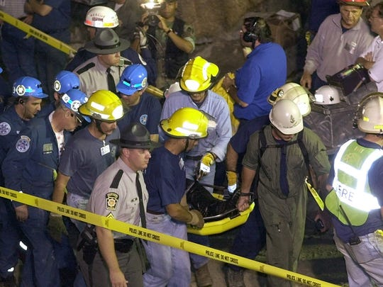 The first of the freed miners, Randy Fogel, 43, is carried on a stretcher at the Quecreek Mine in Somerset, Pa., early Sunday July 28, 2002.