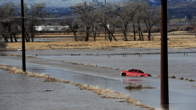 Standing water is seen on the flood plain surrounding the Reno/Sparks Southeast Connector just south of the Sparks Industrial Complex and the Truckee River on Jan. 9, 2017.