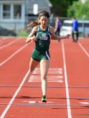 Oak Harbor's Athena Eli completes in the girls 200m
