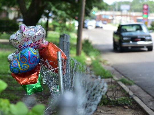 Balloons and a stuffed animal were hung on a fence as a memorial for Promise Hampton, 15, and Bryan Jones, 13, where the two were struck and killed by a vehicle Friday night near Northside Drive and Del Rosa Street.