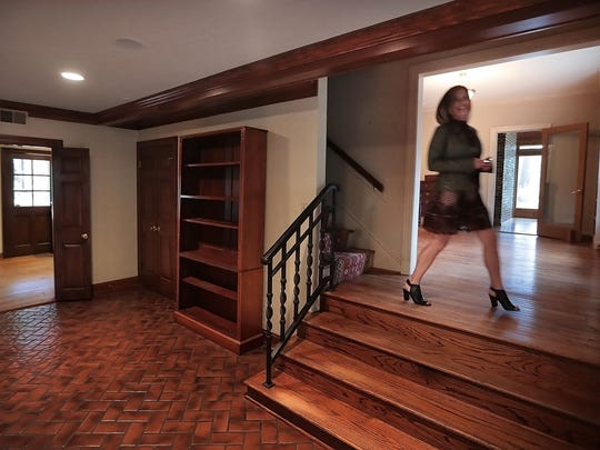 Agent Teri Trotter walks through the property listing