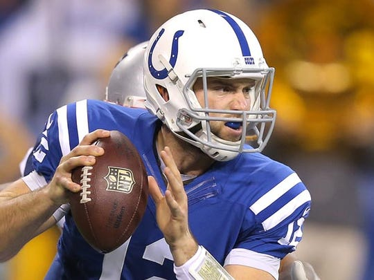Indianapolis Colts quarterback Andrew Luck gets determined looking for a receiver in the first half agains the Patriots. Indianapolis hosted New England at Lucas Oil Stadium on Sunday, November 16, 2014.