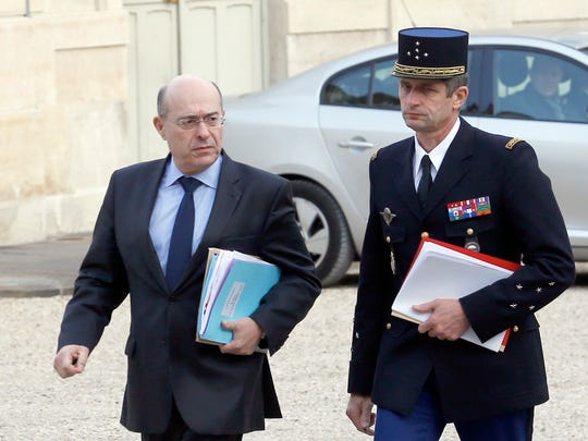 French National Police chief Jean-Marc Falcone, left, and general director of the Gendarmerie Nationale, Gen. Denis Favier,    arrive at the Elysee Palace to attend a  defense council meeting in Paris, France, Saturday, Nov. 14, 2015. French police are hunting possible accomplices of eight assailants who terrorized Paris concert-goers, cafe diners and soccer fans in this country's deadliest peacetime attacks, a succession of explosions and shootings that cast a dark shadow over this luminous tourist destination.(AP Photo/Jacques Brinon)