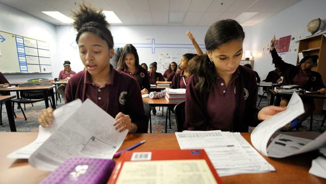 Students working at Tindley Accelerated Schools' girls-only middle school.