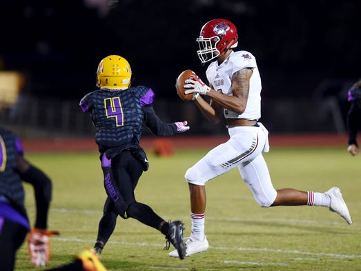 Vero Beach High School wide receiver Jacob Bell catches