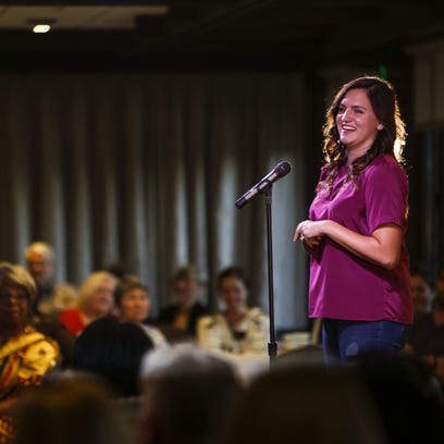 """Joy Shantz, an international student advisor at MSU speaks about growing up in Bangladesh and Malaysia  during the Lansing Storytellers Project event on Sept. 20 at the University Club in East Lansing. The theme of the next event, on Nov. 15, is """"Intoxicants."""""""