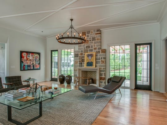 The home features a masonry wood-burning fireplace with Tennessee fieldstone and mitered limestone surround.