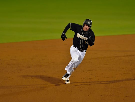 Junior outfielder Matt Diorio heads to third base in