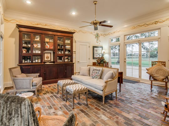For the sunroom floor, the couple used old bricks that